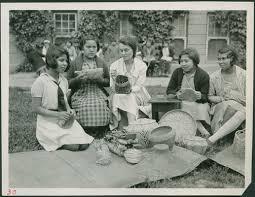 Young girls practicing basket weaving